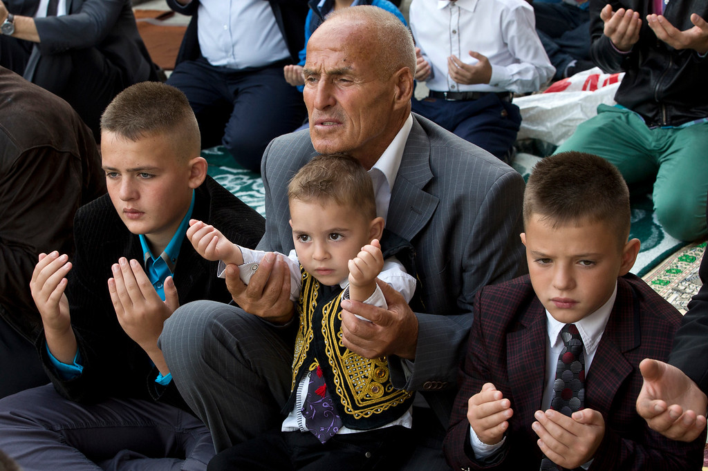 . Kosovars offer Eid al-Adha prayers outside Sultan Mehmet Fatih mosque in capital Pristina, Monday, Sept. 12, 2016. Muslims around the world will celebrate Eid al-Adha in local language, the Festival of Sacrifice, to mark the end of the hajj pilgrimage by slaughtering sheep, goats, cows to commemorate Prophet Abraham\'s readiness to sacrifice his son on God\'s command.(AP Photo/Visar Kryeziu)