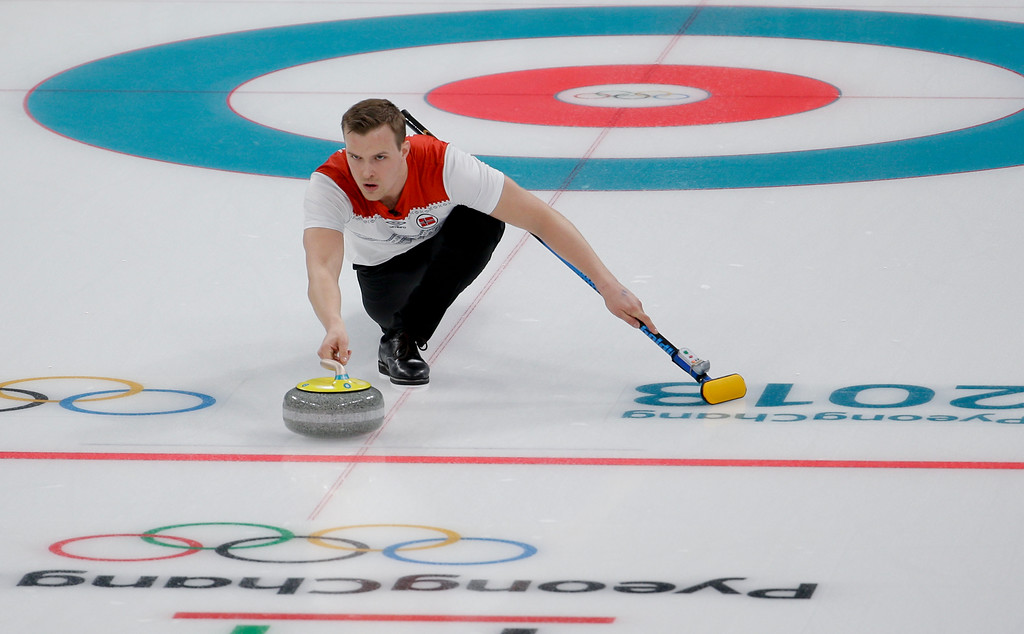 . Norway\'s Magnus Nedregotten throws a stone during a mixed doubles curling match against China\'s Wang Rui and Ba Dexin at the 2018 Winter Olympics in Gangneung, South Korea, Sunday, Feb. 11, 2018. (AP Photo/Natacha Pisarenko)