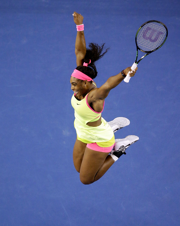 . Serena Williams of the U.S. celebrates after defeating Maria Sharapova of Russia in their women\'s singles final at the Australian Open tennis championship in Melbourne, Australia, Saturday, Jan. 31, 2015. (AP Photo/Lee Jin-man)