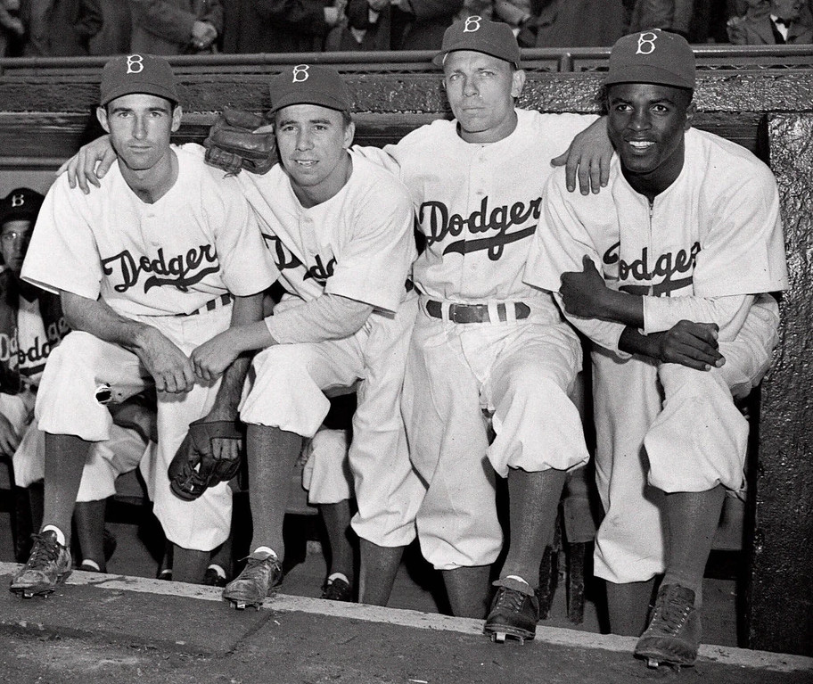 . FILE - In this April 15, 1947 file photo,  from left, Brooklyn Dodgers baseball players John Jorgensen, Pee Wee Reese, Ed Stanky and Jackie Robinson pose at Ebbets Field in New York.   (AP Photo, File)