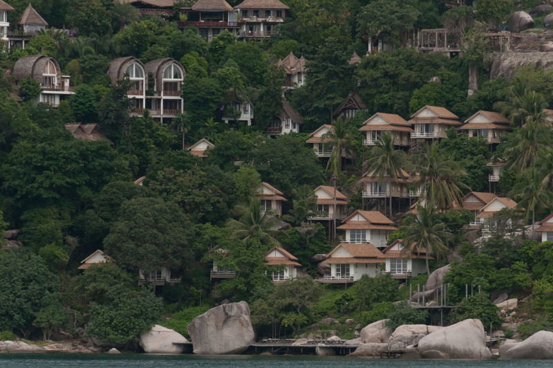 Closer shot of resort huts on hillside at Ko Samui, Thailand