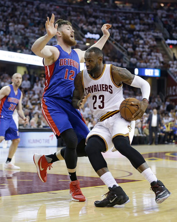 . Cleveland Cavaliers\' LeBron James (23) drives past Detroit Pistons\' Aron Baynes (12), from Australia, during the first half in Game 2 of a first-round NBA basketball playoff series, Wednesday, April 20, 2016, in Cleveland. The Cavaliers won 107-90. (AP Photo/Tony Dejak)