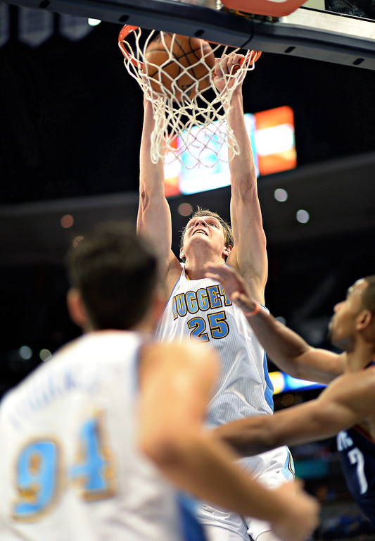. Timofey Mozgov of Denver Nuggets (25) dunks in the second quarter of the game. (Photo by Hyoung Chang/The Denver Post)