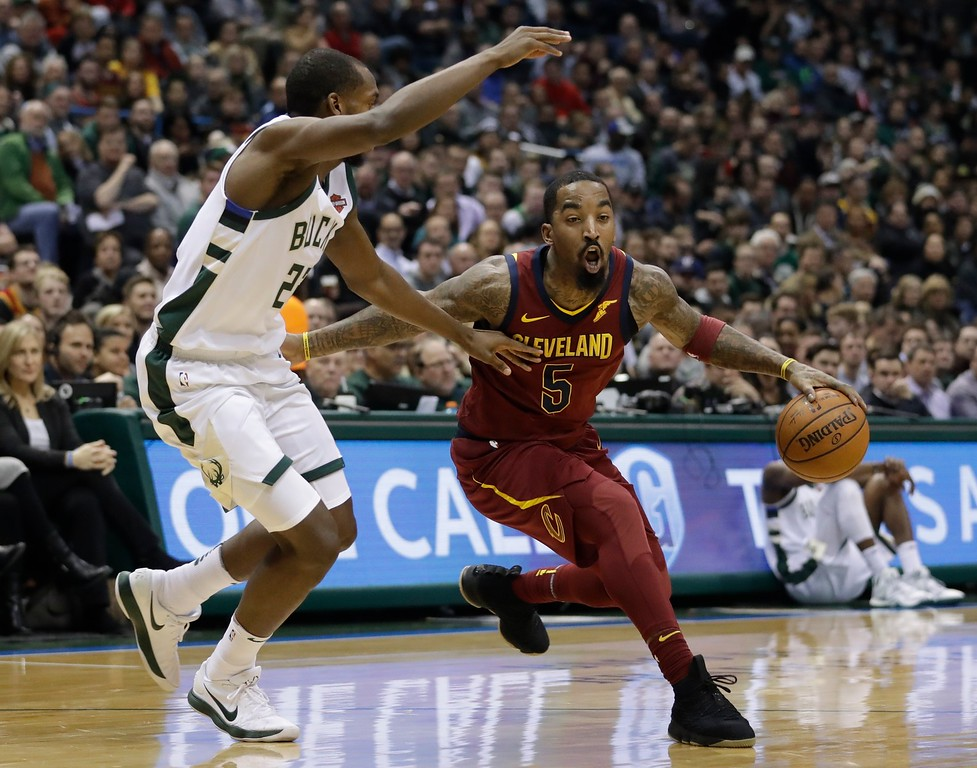 . Cleveland Cavaliers\' JR Smith drives past Milwaukee Bucks\' Khris Middleton during the first half of an NBA basketball game Tuesday, Dec. 19, 2017, in Milwaukee. (AP Photo/Morry Gash)