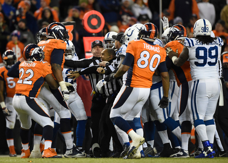 . The teams get in a scuffle in the third quarter. The Denver Broncos played the Indianapolis Colts in an AFC divisional playoff game at Sports Authority Field at Mile High in Denver on January 11, 2015. (Photo by AAron Ontiveroz/The Denver Post)