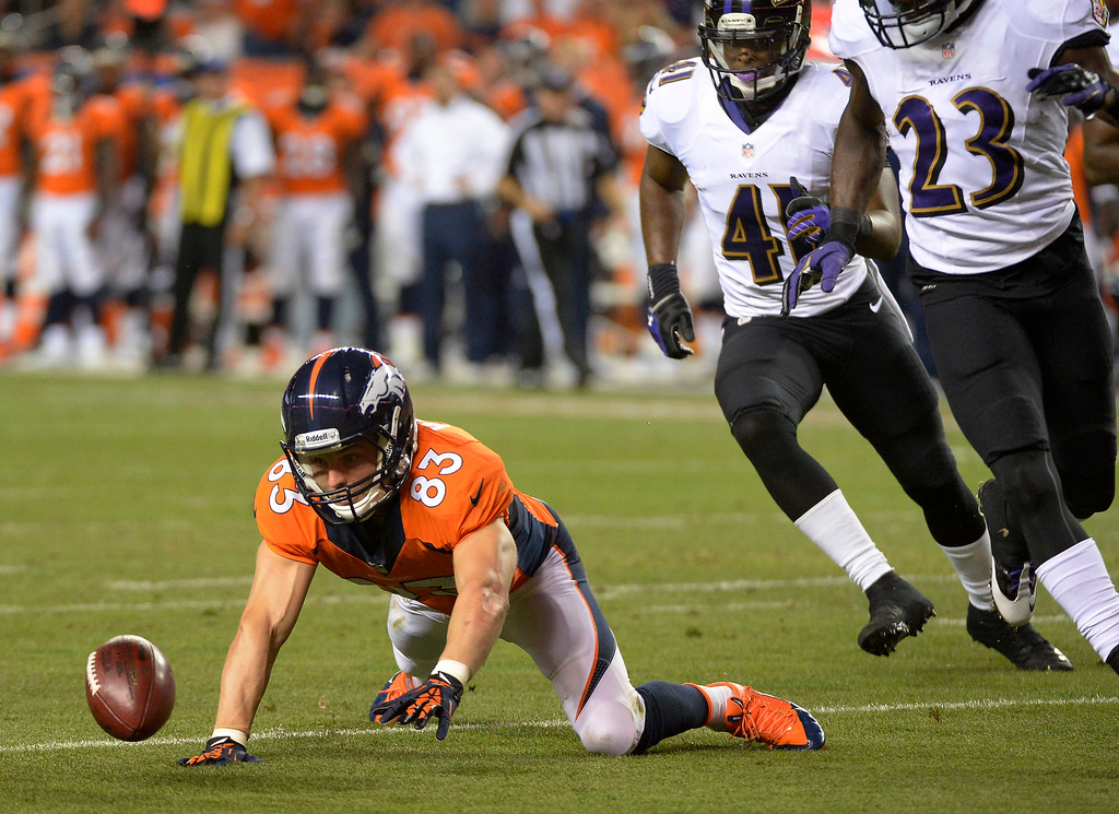 . Denver Broncos wide receiver Wes Welker (83) fumbles the ball in the second quarter.   (Photo by John Leyba/The Denver Post)