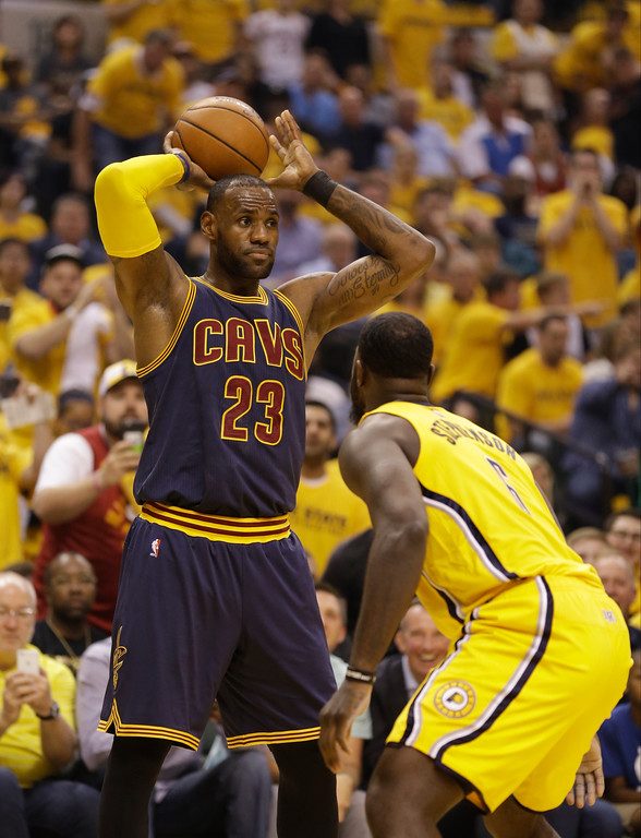 . Cleveland Cavaliers\' LeBron James is defended by Indiana Pacers\' Lance Stephenson during the first half in Game 3 of a first-round NBA basketball playoff series, Thursday, April 20, 2017, in Indianapolis. (AP Photo/Michael Conroy)