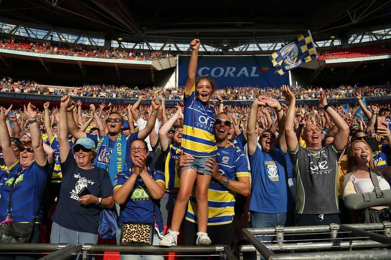 Warrington fans celebrate during the Coral Challenge Cup Final at Wembley Stadium