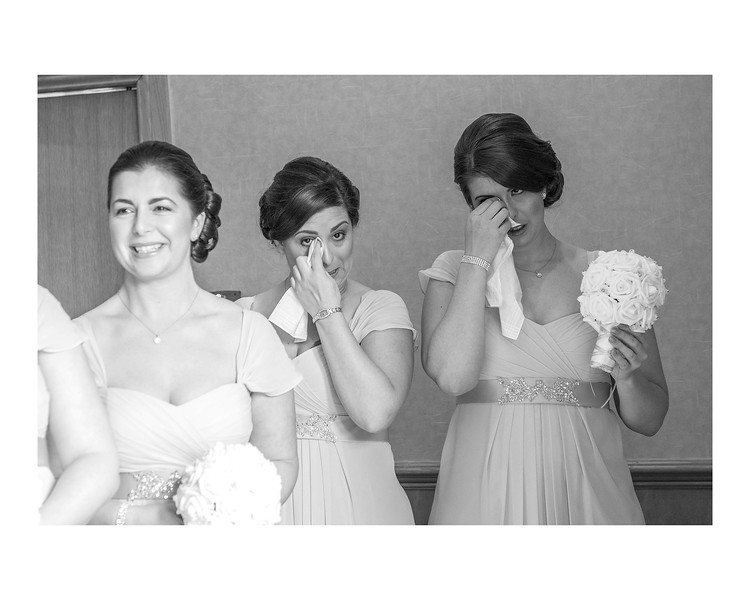Wedding Photography of Nina & Scott, Grange Manor Hotel, Grangemouth, Falkirk, Scotland, Photograph is of the Bridemaids crying during the ceremony