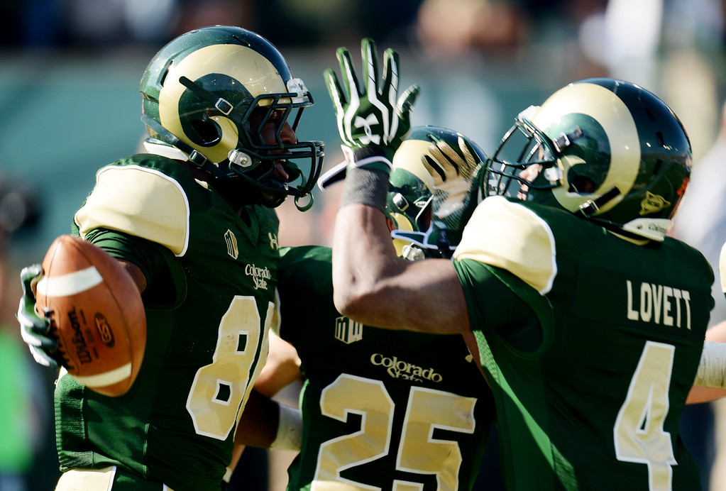 . FORT COLLINS, CO - OCTOBER 12 : From left, Kivon Cartwright of Colorado State (86) celebrates his touchdown with Joe Hansley (25) and Charles Lovett (4) in the 2nd quarter of the game against San Jose State at Hughes Stadium. Fort Collins. Colorado. October 12, 2013. San Jose won 34-27. (Photo by Hyoung Chang/The Denver Post)