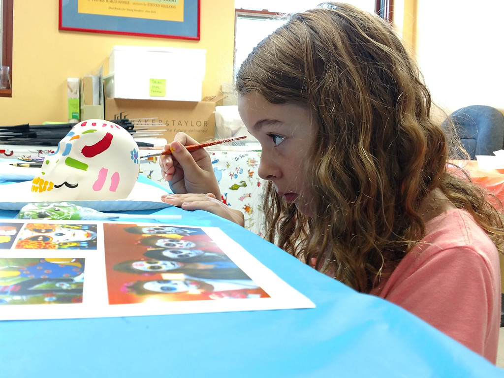 . Sarah Prichard paints flowers on the back of her skull during Studio MPL at Mentor Public Library. (Courtesy Mentor Public Library)