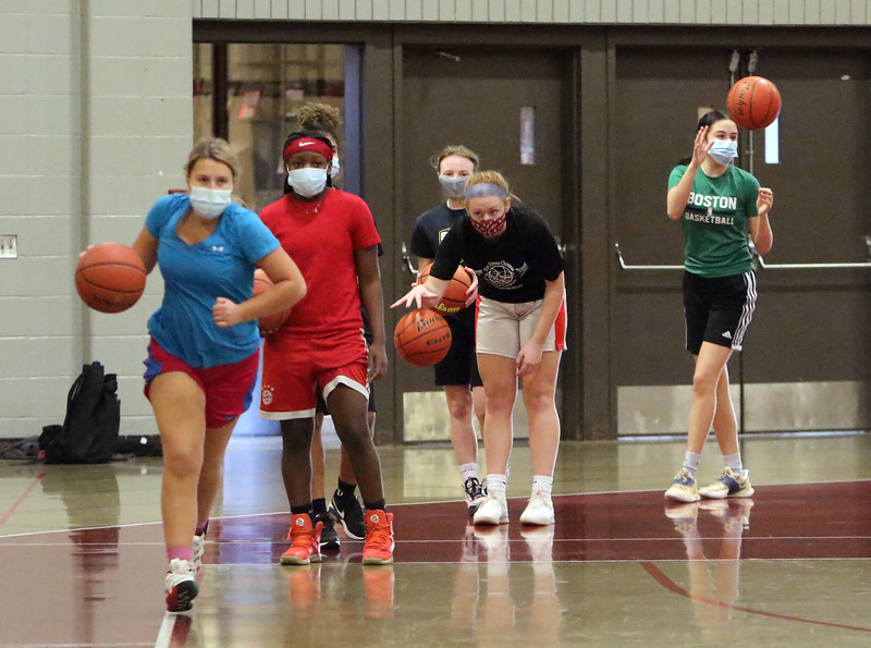 Lowell High girls basketball practice. From left, sophomores Ashlee Anderson and Pearl Kalungi, freshman Maya Petterson, senior Ella Haley and junior Vanessa Gagnon, during a drill. (SUN/Julia Malakie)