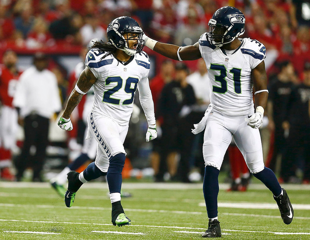 . Seattle Seahawks free safety Earl Thomas (L) celebrates his interception on the Atlanta Falcons with teammate Kam Chancellor during the fourth quarter in their NFL NFC Divisional playoff football game in Atlanta, Georgia January 13, 2013. REUTERS/Chris Keane