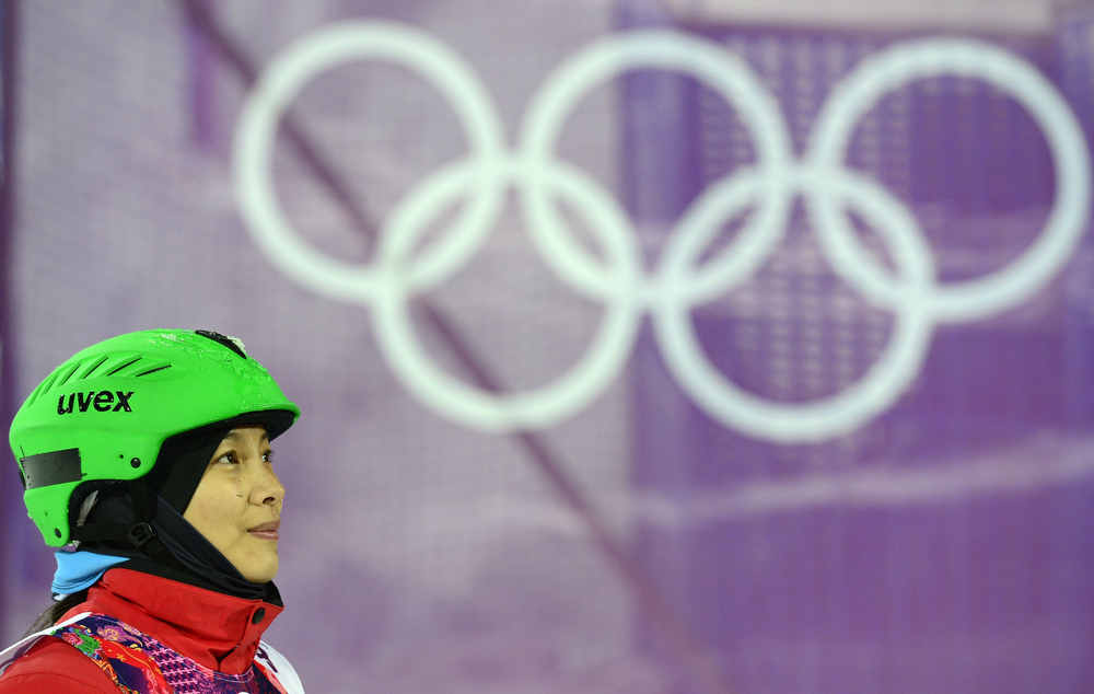 . China\'s Li Nina watches the results in the Women\'s Freestyle Skiing Aerials finals at the Rosa Khutor Extreme Park during the Sochi Winter Olympics on February 14, 2014.  (JAVIER SORIANO/AFP/Getty Images)