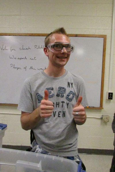 Andrew Wegner gives one of his many thumbs up during VEX preparation