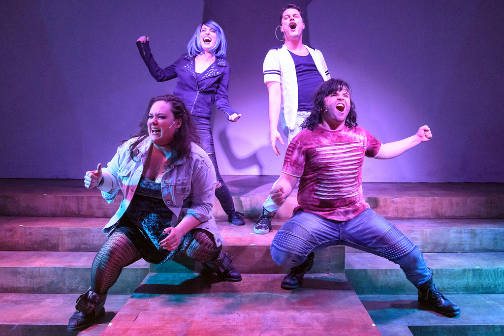 . Kate Michalski, left, Neely Gevaart, Danny Simpson, and Tony Heffner perform in the Black Canvas Theatre production of �We Will Rock You.� The show continues through Aug. 18. For more information, visit blankcanvastheatre.com. (Andy Dudik)