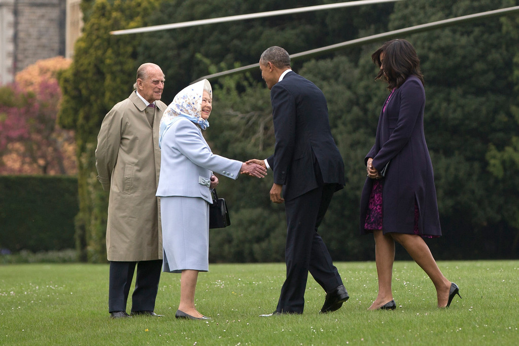 . President Barack Obama and first lady Michelle Obama are greeted by Queen Elizabeth II and Prince Philip as they arrive on Marine One at Windsor Castle in Windsor, England, Friday, April 22, 2016. (AP Photo/Carolyn Kaster)