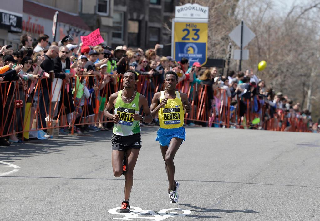 . Lemi Berhanu Hayle, left, and Lelisa Desisa, both of Ethiopia, run through Brookline, Mass., during the 120th Boston Marathon on Monday, April 18, 2016. (AP Photo/Steven Senne)
