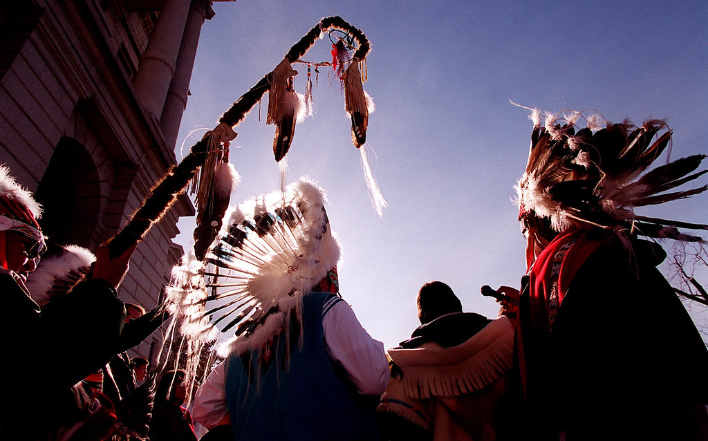 . Members of the Northern Cheyenne Tribe and other tribes  gathered Monday morning to sing an honor song to remember the  past and to look toward the future during the 135th anniversary  of the Sand Creek Massacre on the west steps of the State Capital in Denver, Colorado on November 29, 1999.  Runners took part in a 170 mile spiritual healing run from the  site of the massacre to the Capital. (LEW SHERMAN/THE DENVER POST)