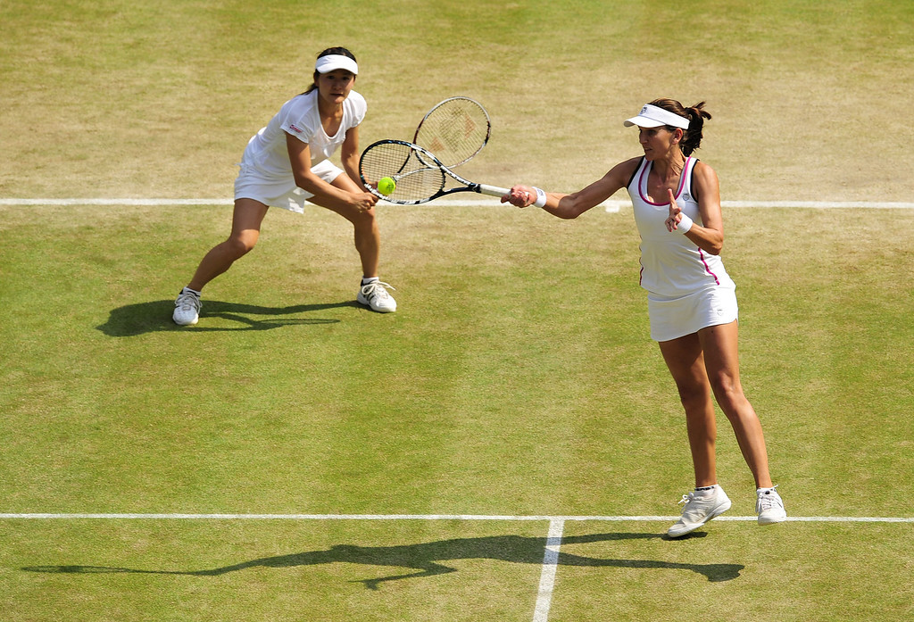 . Japan\'s Shuko Aoyama (L) and South Africa\'s Chanelle Scheepers play against China\'s Peng Shuai and Taiwan\'s Hsieh Su-Wei during their ladies doubles semi-final match on day eleven of the 2013 Wimbledon Championships tennis tournament at the All England Club in Wimbledon, southwest London, on July 5, 2013. GLYN KIRK/AFP/Getty Images