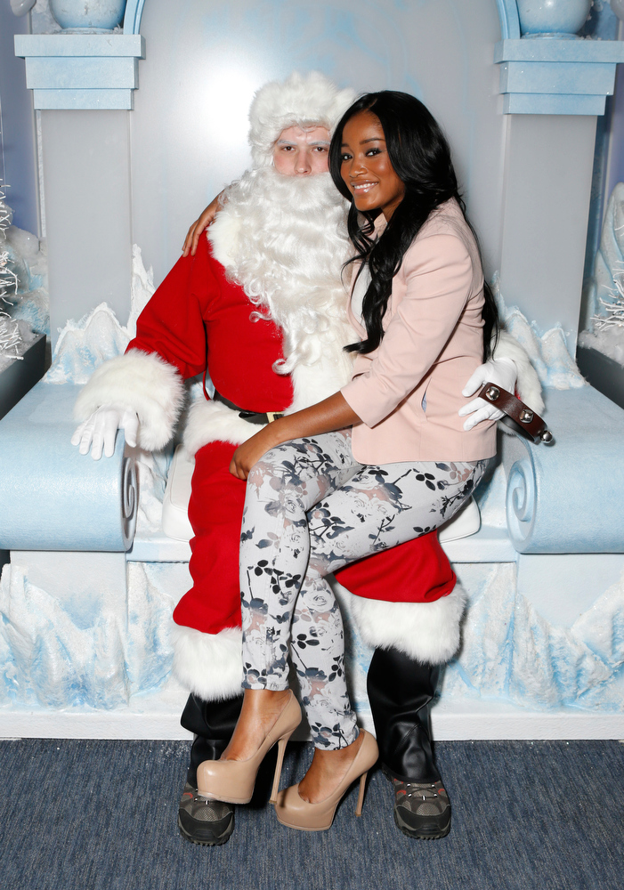 ". Santa Claus and Keke Palmer celebrate the December 11th Blu-ray, DVD and Digital HD release of ICE AGE: CONTINENTAL DRIFT at the Beverly Center in Los Angeles on Tuesday, Dec. 6, 2012. Twentieth Century Fox Home Entertainment and Taubman Shopping Centers across the country have partnered to commemorate ""National Signing Santa Day\"" and the industry first Blu-ray special feature with picture-in-picture sign language interpretation.(Photo by Todd Williamson/Invision for Twentieth Century Fox Home Entertainment / AP Images)"