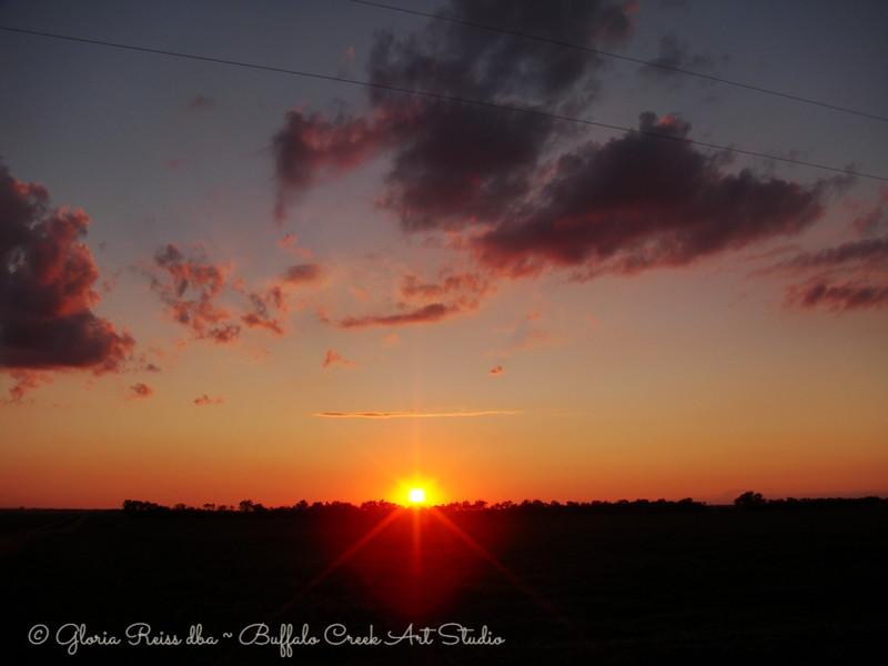 sun setting on the prairie