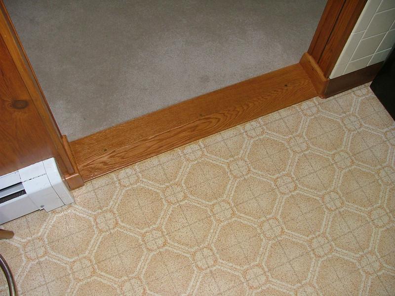 flooring between den and kitchen