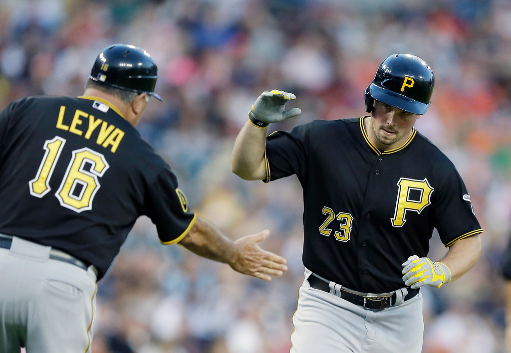 . Pittsburgh Pirates\' Travis Snider is greeted by third base coach Nick Leyva after his two-run home run during the fourth inning of an interleague baseball game against the Detroit Tigers, Wednesday, Aug. 13, 2014 in Detroit. (AP Photo/Carlos Osorio)