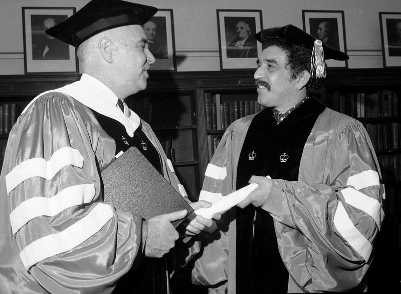 . William James McGill, left, president of Columbia University, presents an honorary degree to novelist Gabriel Garcia Marquez of Bogota, Colombia, June 1, 1971. The scroll is a stand-in for the real scroll which will be given to Garcia Marquez during commencement exercises. (AP Photo/Marty Lederhandler)