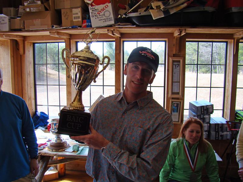 Kip Knight accepts the Baic Cup on behalf of the juniors in the Vasa Ski Club.