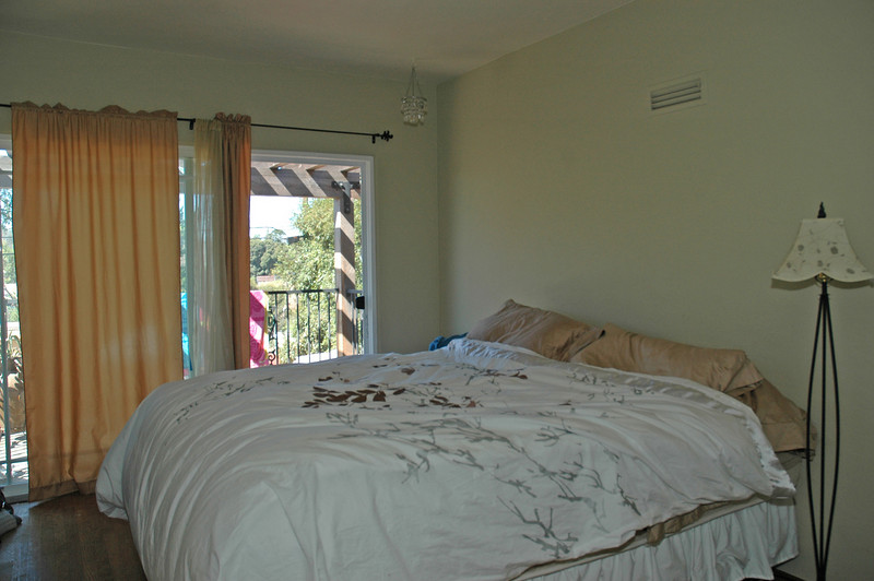 The master bedroom features a balcony, walk-in closet and a remodeled master bathroom.