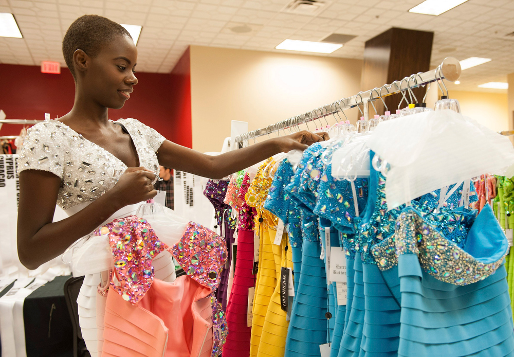 . Tara Edward of St. Lucia looks at dresses as part of preparations for the Miss Universe 2012 pageant in Las Vegas, Nevada December 4, 2012. The pageant, will be held on December 19, 2012 at the Planet Hollywood Resort & Casino in Las Vegas. REUTERS/Valerie Macon/Handout
