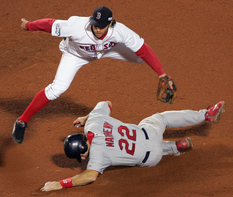 . St. Louis Cardinals\' Mike Matheny, below, is the first half of a double play, put out by Boston Red Sox\' Mark Bellhorn, above, in the fifth inning of game two of the World Series in Boston, Sunday,  Oct. 24, 2004. (AP Photo/Chitose Suzuki)