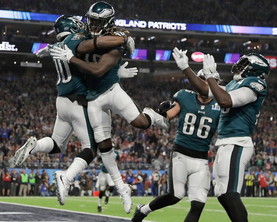 . Philadelphia Eagles\' Corey Clement, left, celebrates his touchdown catch during the second half of the NFL Super Bowl 52 football game against the New England Patriots Sunday, Feb. 4, 2018, in Minneapolis. (AP Photo/Matt Slocum)