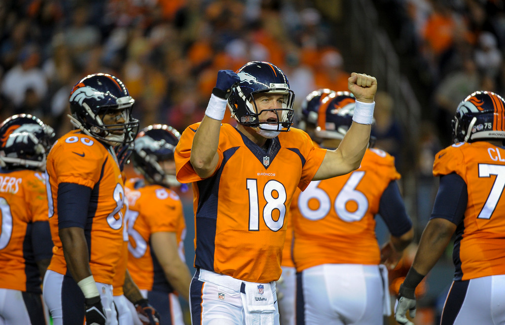 . DENVER, CO - AUGUST 23: Denver Broncos quarterback Peyton Manning (18) calls out signals during the second quarter against the Houston Texans August 23, 2014 at Sports Authority Field at Mile High Stadium. (Photo by John Leyba/The Denver Post)