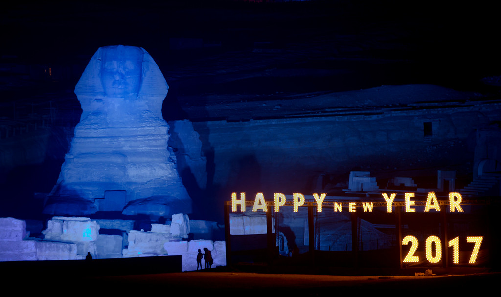. Blue light is cast on Sphinx at the historical site of Giza Pyramids to celebrate the New Year in Egypt, Sunday, Jan. 1, 2017. (AP Photo/Amr Nabil)