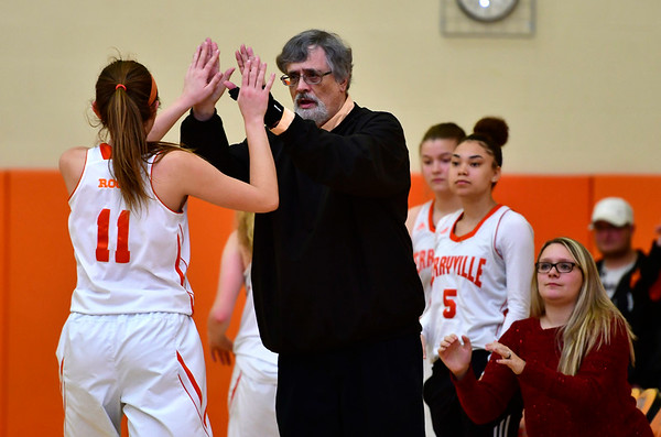 12/21/2018 Mike Orazzi | Staff Terryville's Jordan Conklin (11) and head coach Tom Morgan during Friday night's girls basketball game with Litchfield in Plymouth.
