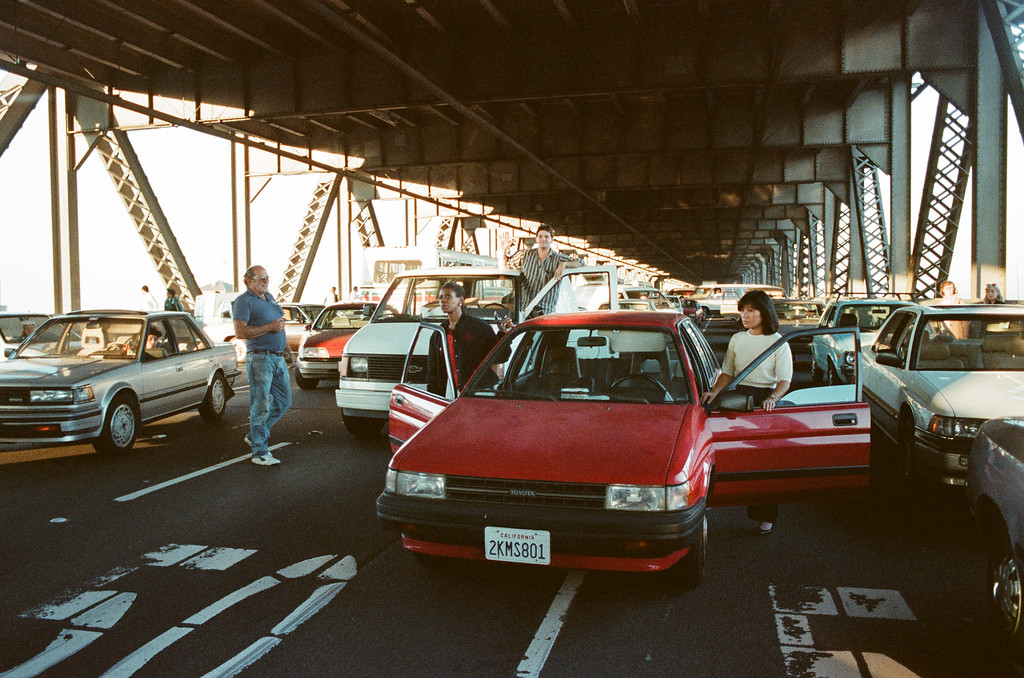 . FILE - In this photo taken Oct. 17, 1989, motorists turn their cars around and wait to drive back to San Francisco after the upper deck of the Bay Bridge collapsed onto the lower deck in the Loma Prieta earthquake in San Francisco.   (AP Photo/George Nikitin)