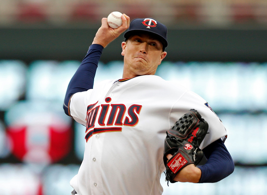 . Minnesota Twins pitcher Kyle Gibson throws against the Cleveland Indians in the first inning of the first game of a baseball doubleheader Thursday, Aug. 17, 2017, in Minneapolis. (AP Photo/Jim Mone)