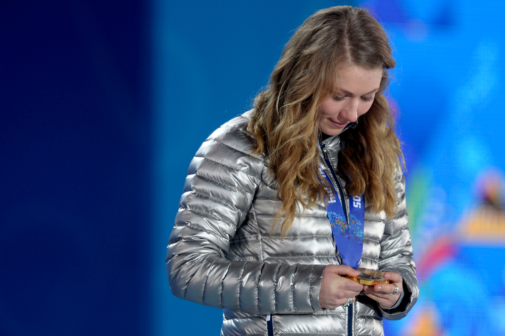 Description of . American Mikaela Shiffrin looks at her gold medal during the ladies' slalom medals ceremony. Sochi 2014 Winter Olympics on Friday, February 22, 2014 at Sochi Olympic Park. (Photo by AAron Ontiveroz/ The Denver Post)