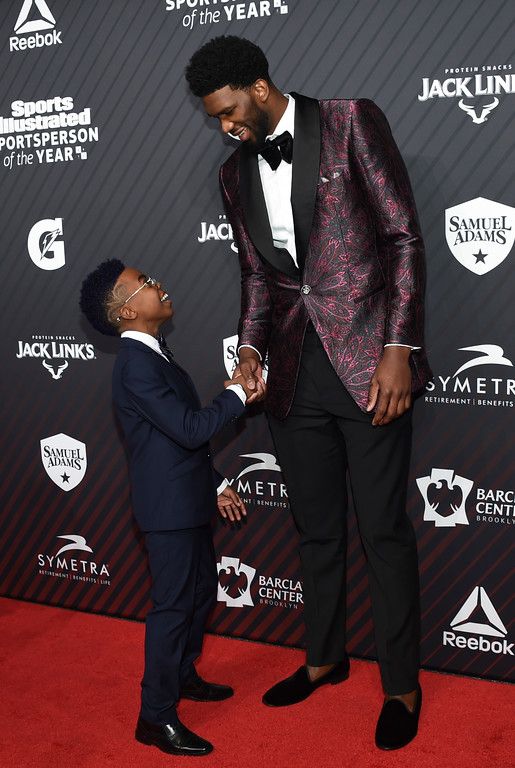 ". S.I. Kids SportsKid of the Year honoree Maxwell ""Bunchie\"" Young, left, meets rising star award recipient Joel Embiid at the Sports Illustrated 2017 Sportsperson of the Year Awards at Barclays Center on Tuesday, Dec. 5, 2017, in New York. (Photo by Evan Agostini/Invision/AP)"