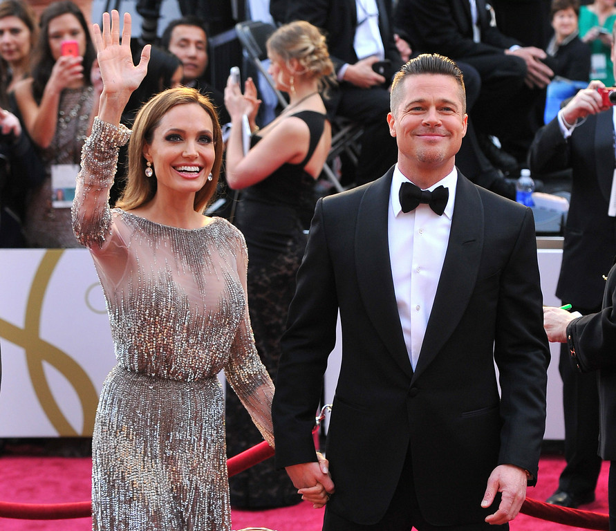 . FILE - In this Sunday, March 2, 2014, file photo, Angelina Jolie, left, and Brad Pitt arrive at the Oscars at the Dolby Theatre in Los Angeles. (Photo by Vince Bucci/Invision/AP, File)