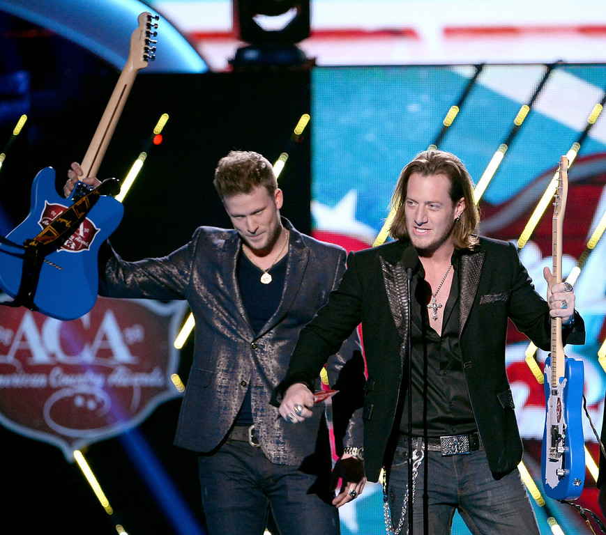 . Recording artists Brian Kelley (L) and Tyler Hubbard of Florida Georgia Line accept the Single of the Year award onstage during the 2013 American Country Awards at the Mandalay Bay Events Center on December 10, 2013 in Las Vegas, Nevada.  (Photo by Ethan Miller/Getty Images)