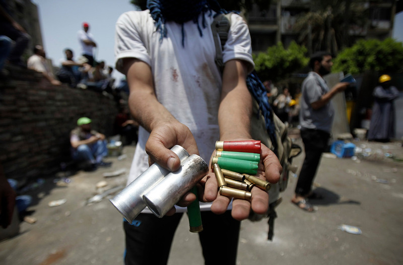. A member of the Muslim Brotherhood and supporter of deposed Egyptian President Mohamed Mursi displays spent ammunition after clashes with army in front of Republican Guard headquarters in Nasr City, in the suburb of Cairo July ,8 2013. REUTERS/Amr Abdallah Dalsh
