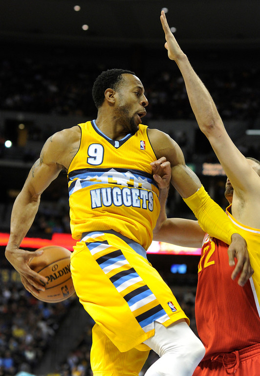 . DENVER, CO. - APRIL 6: Andre Iguodala (9) of the Denver Nuggets made a pass behind his back in the first half. The Denver Nuggets defeated the Houston Rockets 132-114 at the Pepsi Center Saturday night, April 6, 2013. Photo By Karl Gehring/The Denver Post)