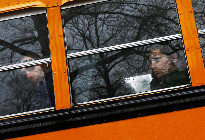 . Newtown school district students are seen in a school bus in Newtown, Connecticut December 18, 2012. The schools of Newtown, which stood empty in the wake of a shooting rampage that took 26 of their own at Sandy Hook Elementary, will again ring with the sounds of students and teachers on Tuesday as the bucolic Connecticut town struggles to return to normal.  REUTERS/Shannon Stapleton
