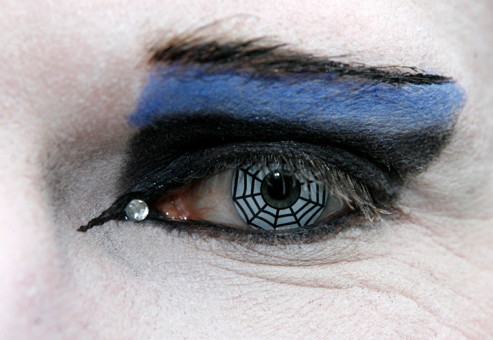 . Close-up on the eye with a contact lens with a a spider\'s net paitning of a participant in an annual Wave-Gothic festival on May 30, 2009 in Leipzig, eastern Germany, where more than 20 000 people are expected to attend the festival attracting the friends of gothic romanticism. The festival offers a very special spectacle with a range of concerts, historical markets, theatre and cinema, gothic scene performances, exhibitions, readings and parties.   AFP PHOTO   DDP/SEBASTIAN WILLNOW