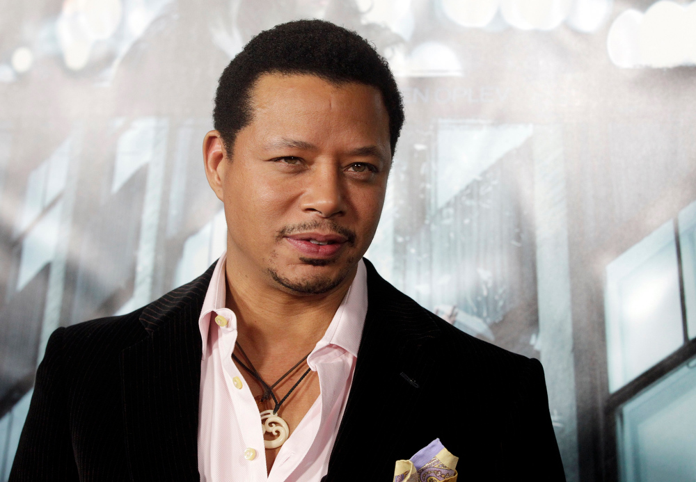 ". Actor Terrence Howard poses at the premiere of his new film ""Dead Man Down\"" in Hollywood February 26, 2013. REUTERS/Fred Prouser"