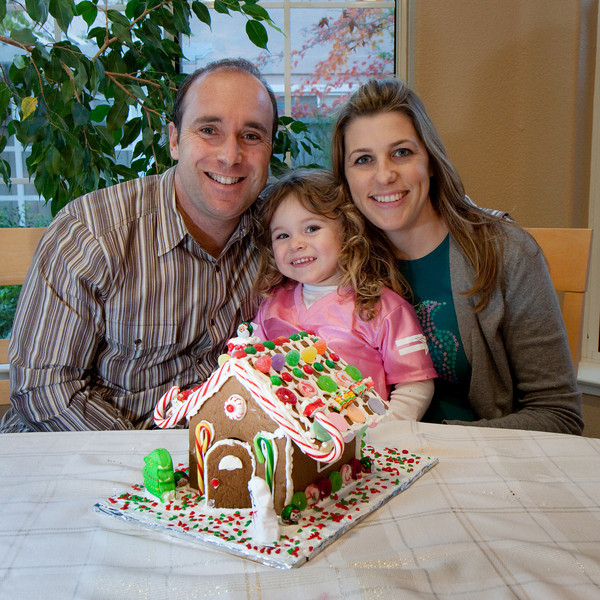 Brett, Ava, and Rebecca show off their fantastic gingerbread house. Looks good enough to eat.