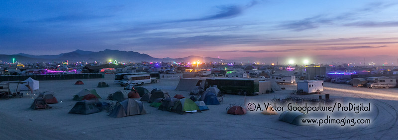 While some of the camp sleeps, in the background Burners are still partying on the Playa.